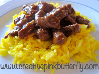 Beef stew with coconut milk and turmeric rice